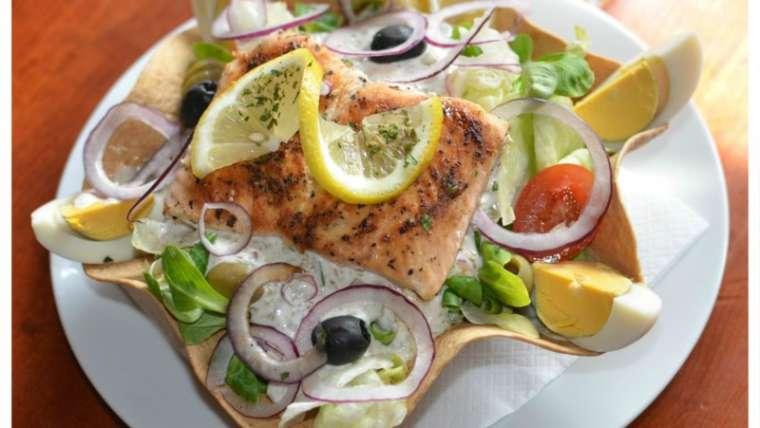 Salmon salad in edible taco plate