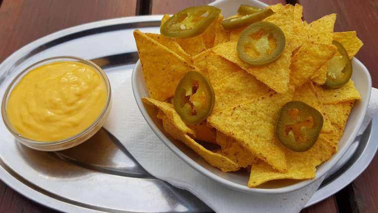 Nacho chips with jalapeno peppers